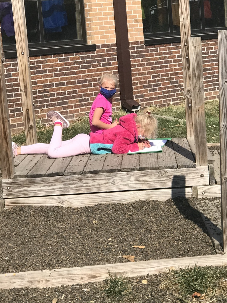 Second graders went outside to see if they could find the 3 states of matter
