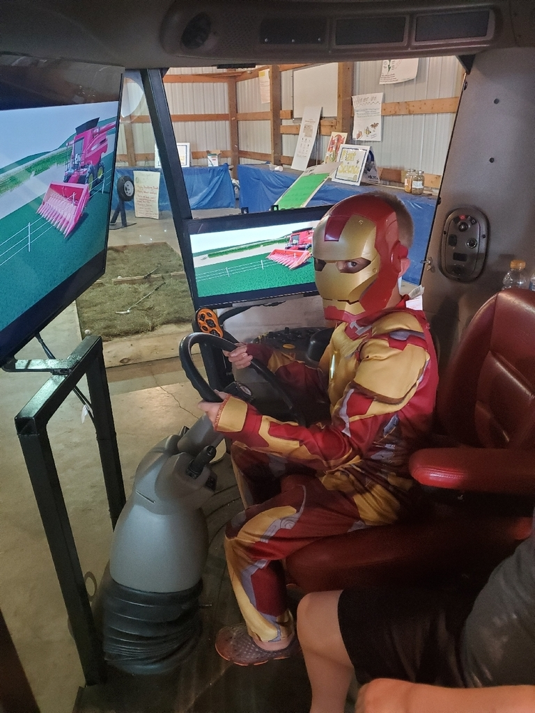 Even Iron Man wants to drive the combine!