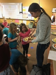 Miss Guzinski passing out apples